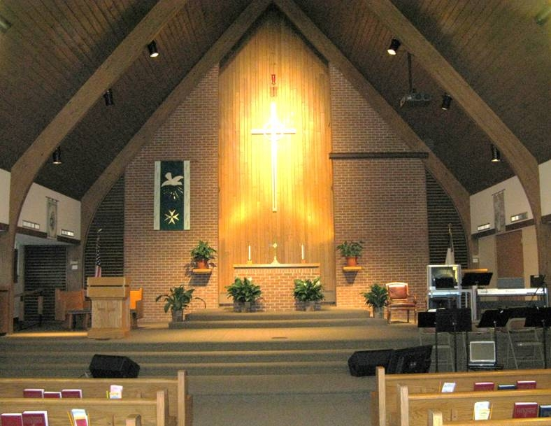 Sanctuary, fully handicap accessible with 17 pews on the south side and 19 on the north side