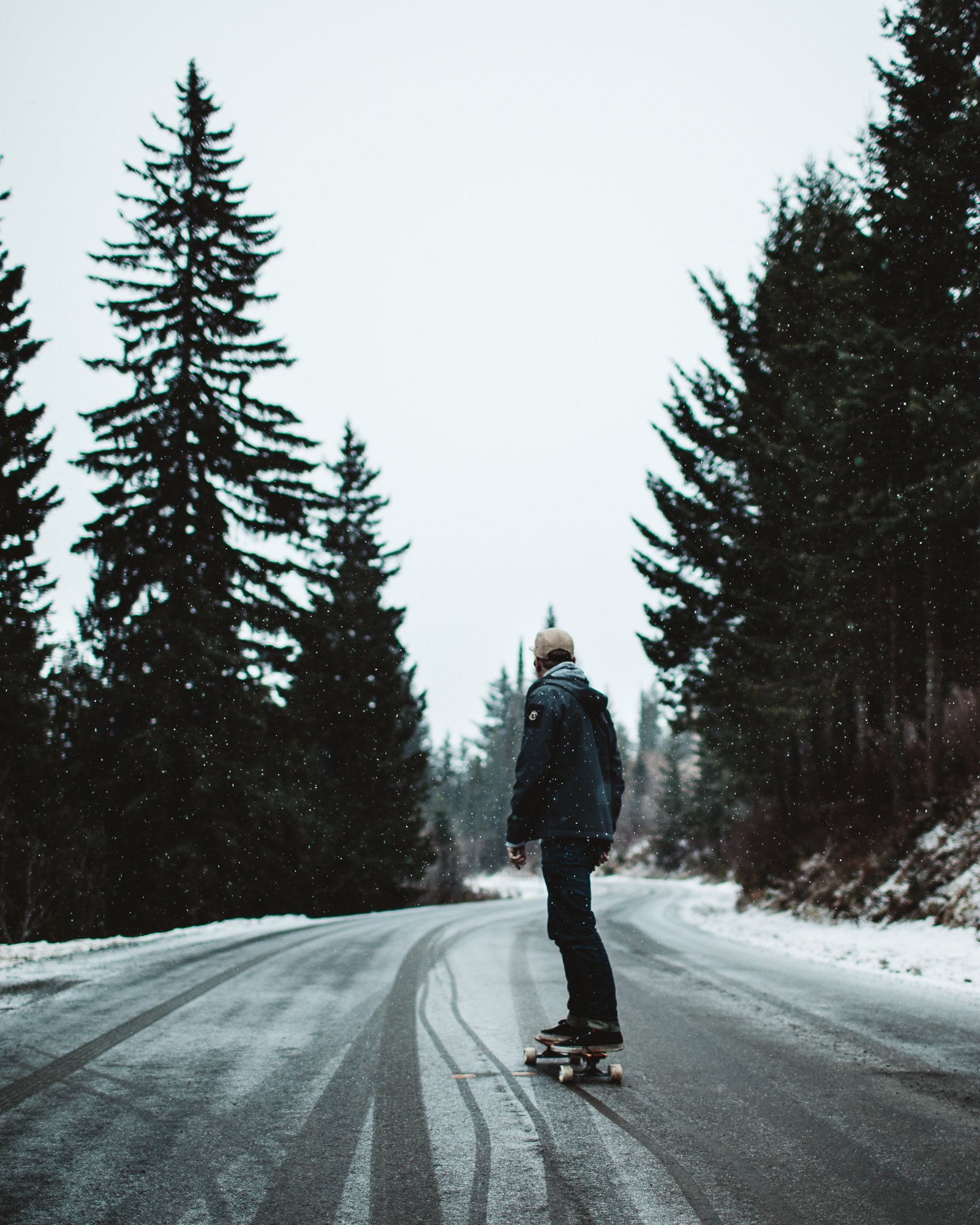 Garrett moving down a mountain in Sandpoint, Idaho.  Thanks to  Cedar Skate  for the board.