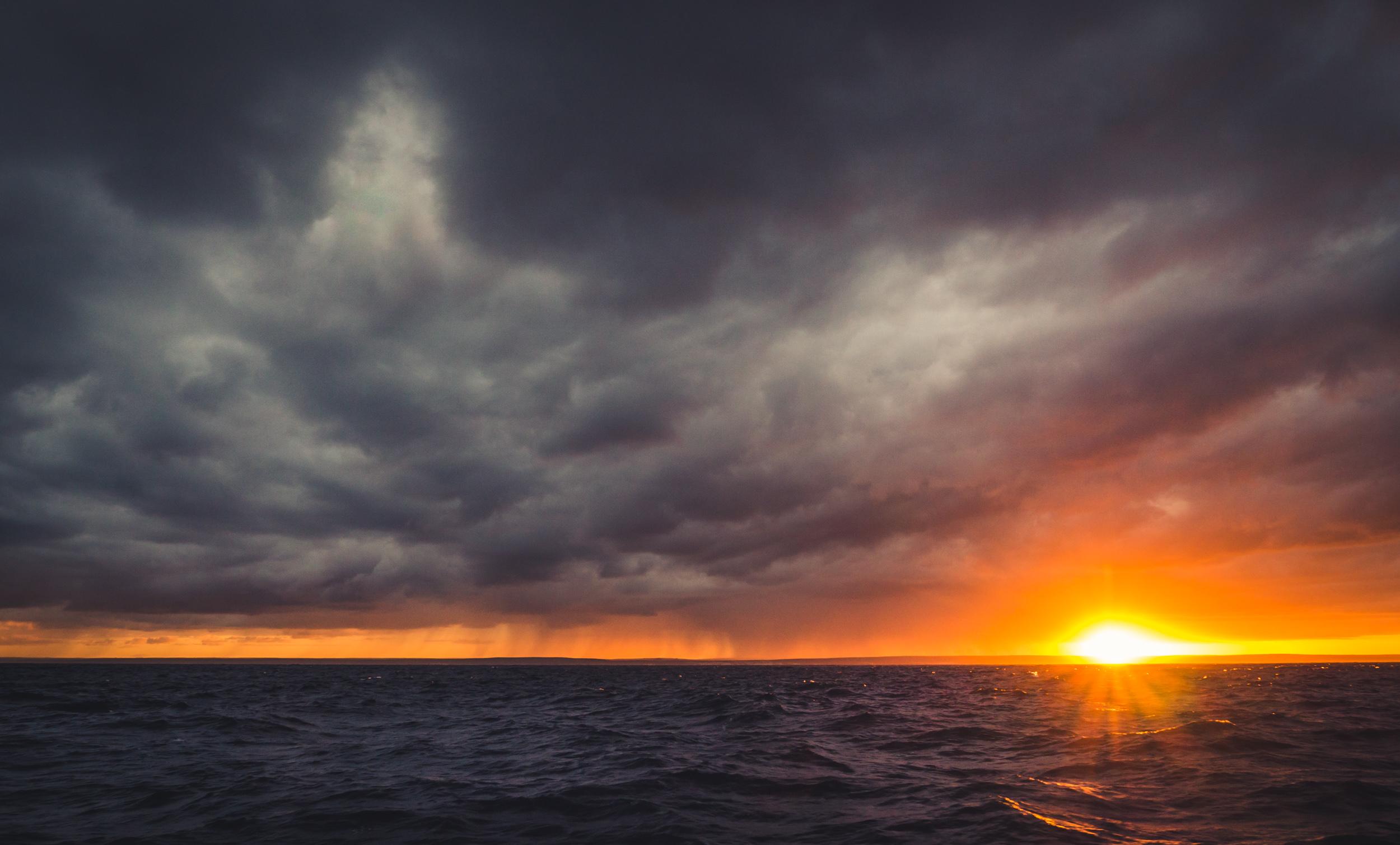 _20 Sunrise over ocean Dark Clouds.jpg