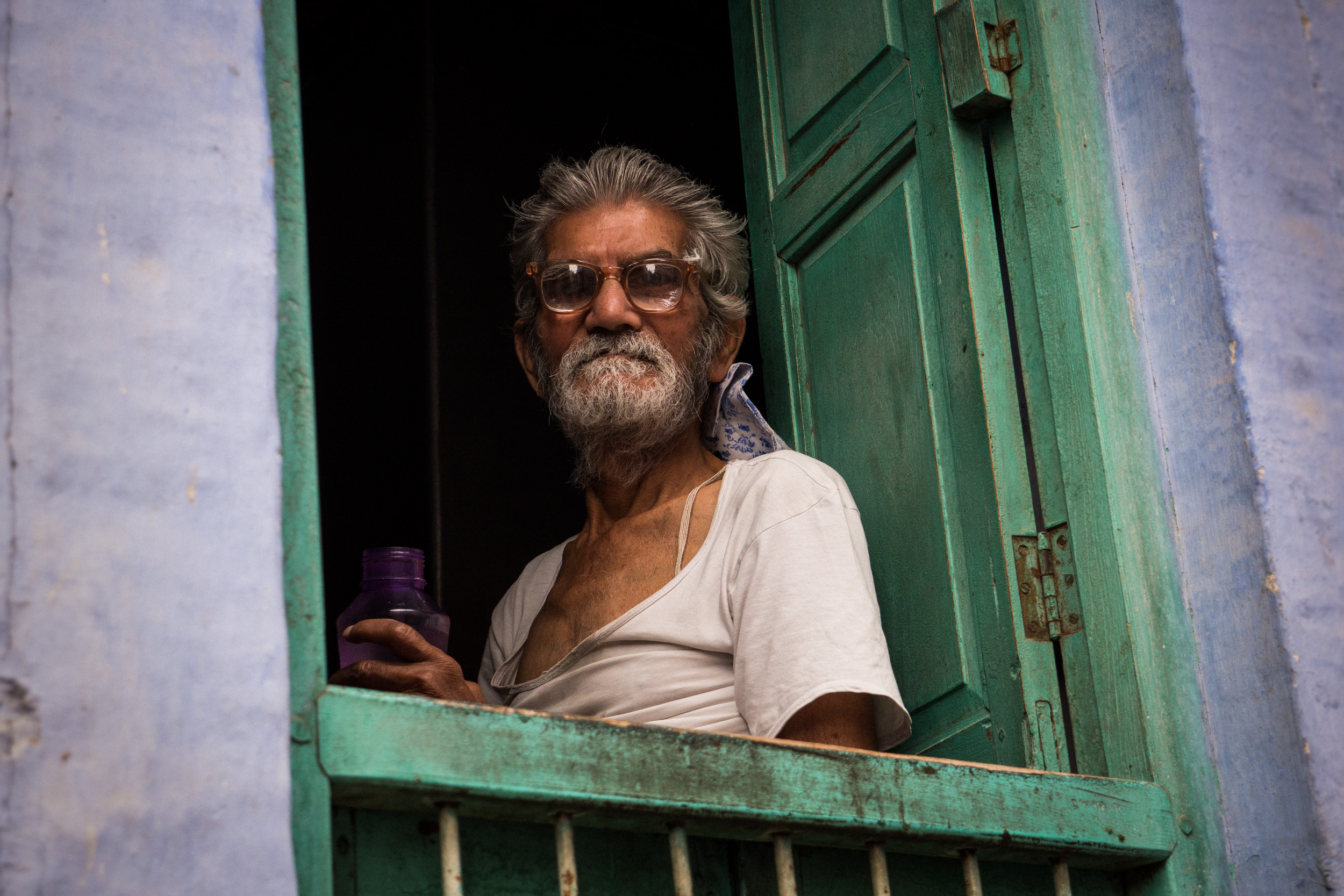 _13 Old man Sitting on Window Jogphur India.jpg
