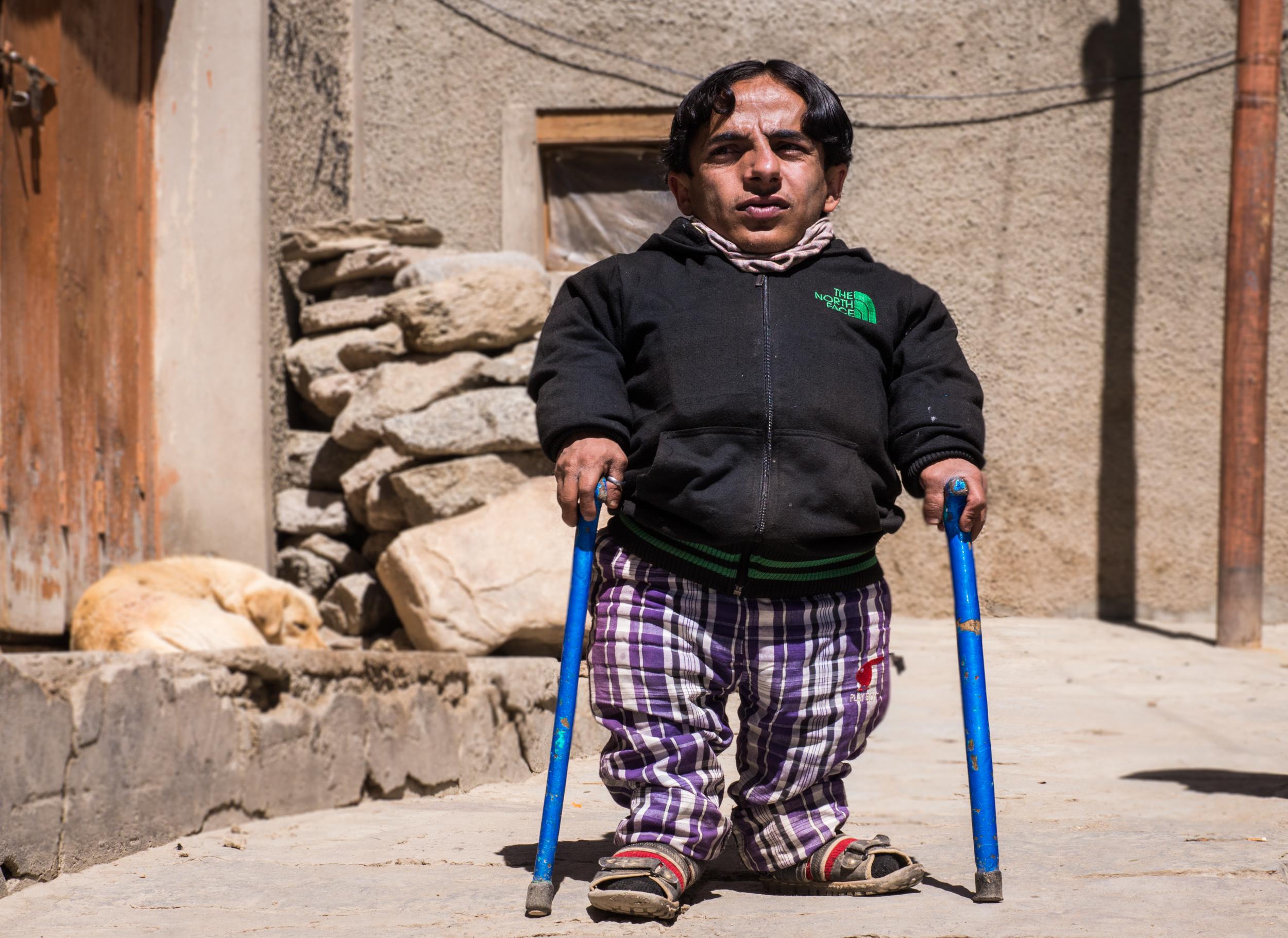 _14 Small man On sticks streets of Leh India.jpg