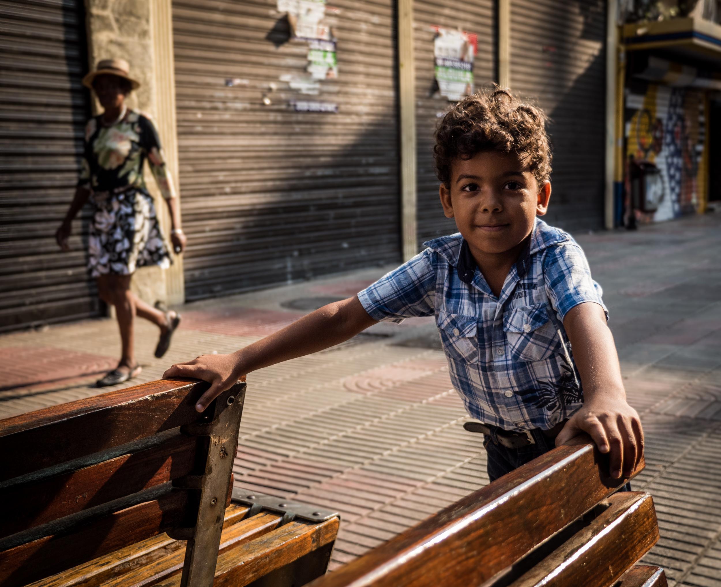 _16 Curious Boy Sun Shadows Streets Dominican Republic.jpg