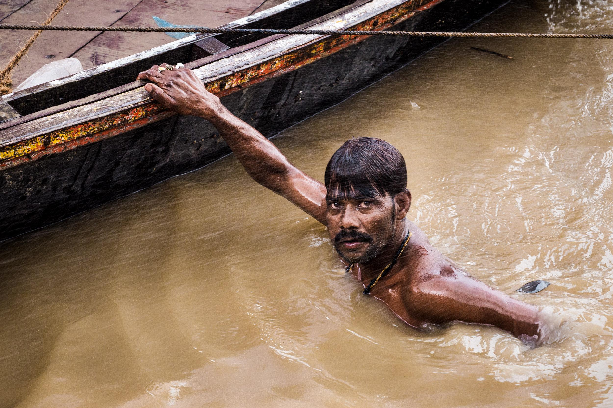 _18 Man Swimming in the Ganges Varranasi India.jpg