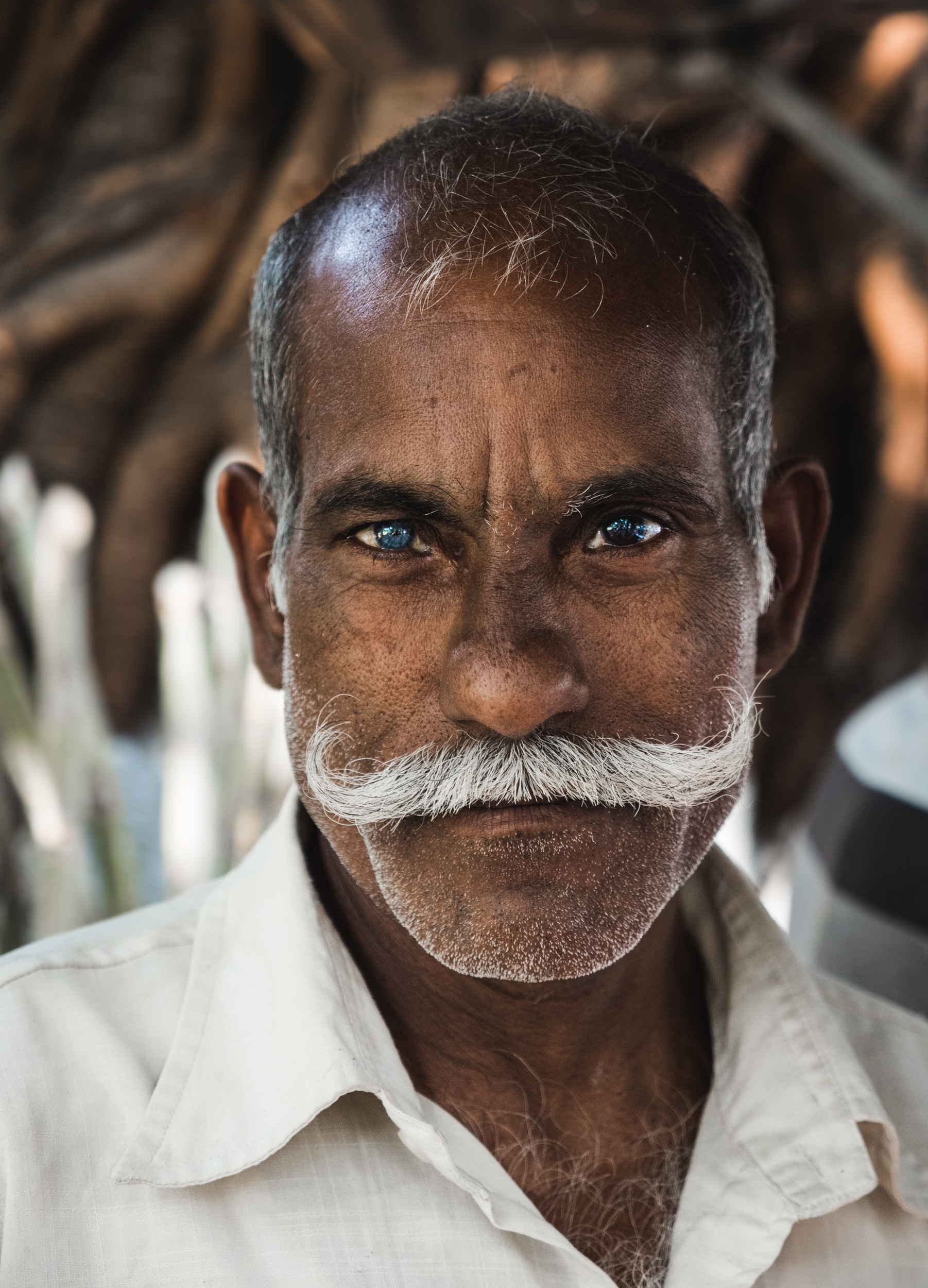 _23 Man with mustache different coloured eyes Mumbai India.jpg