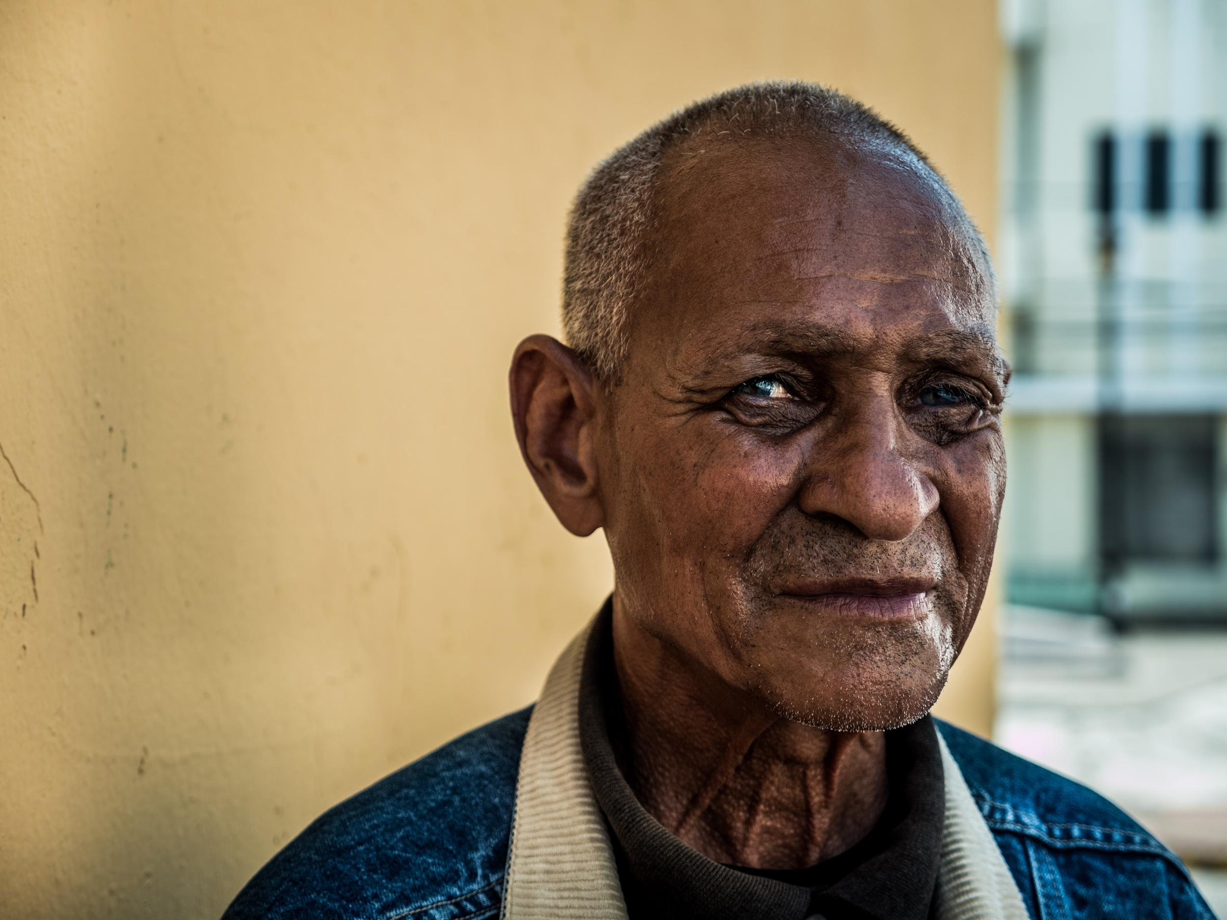 _24 Elderly man dark skin and blue eyes.jpg