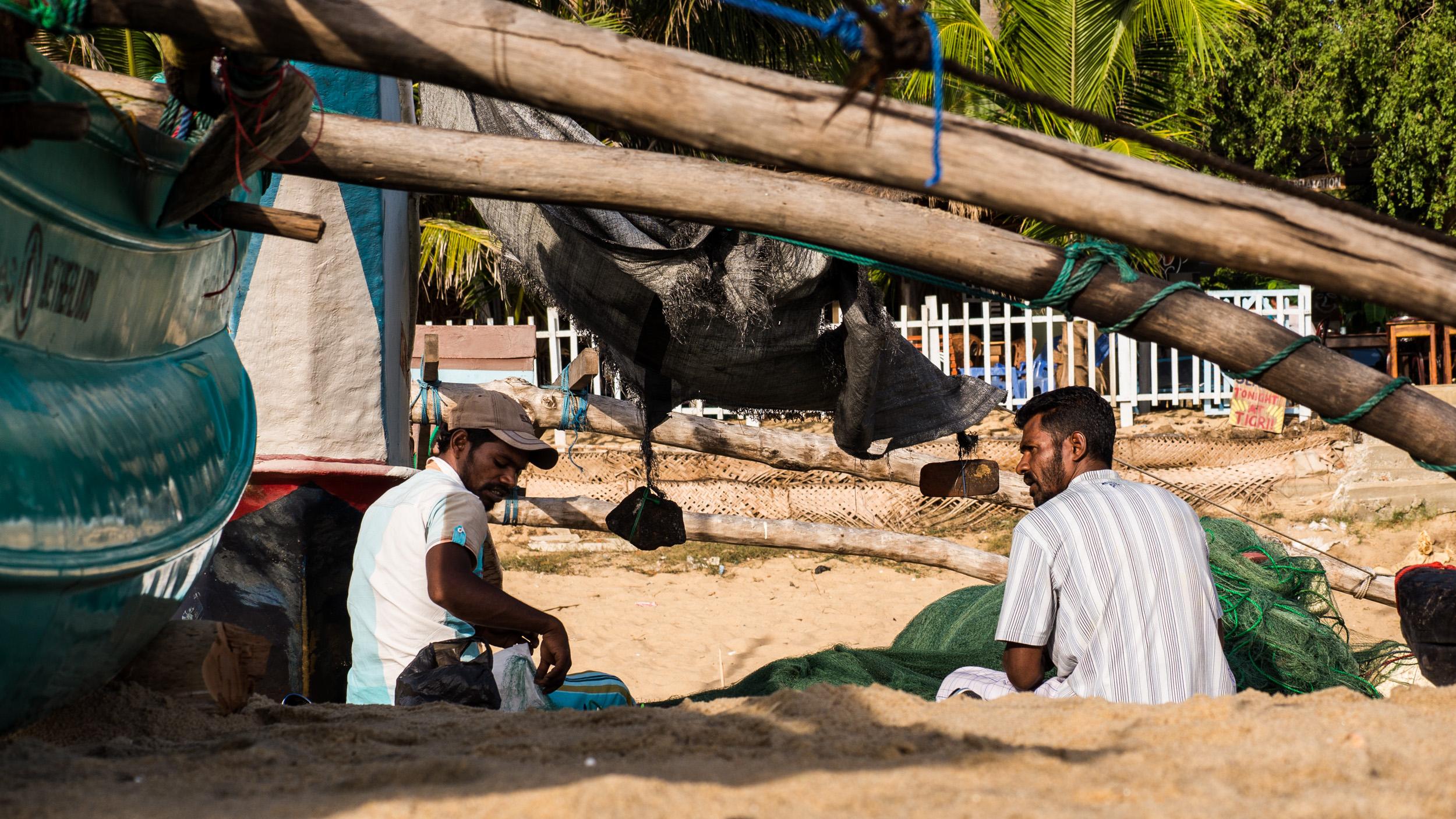 _3 Arugam Bay Fishermen Sitting with nets.jpg