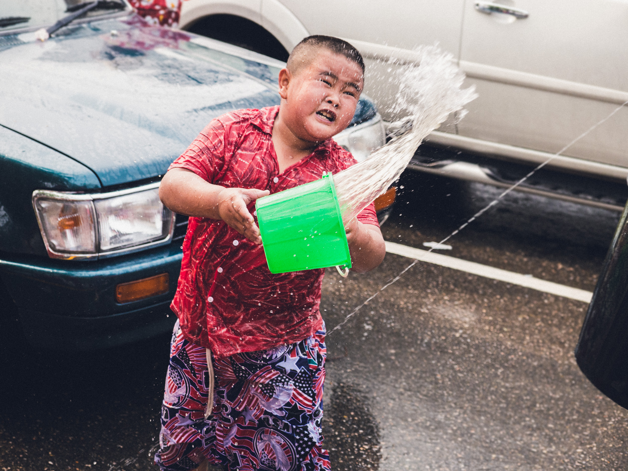 _16 Chubby boy throwing water Chang Mai.jpg