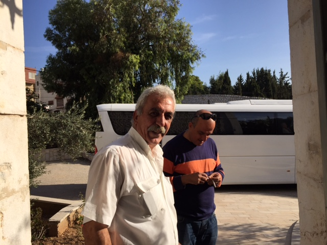 Sami does everything from running the kitchen to repairing the plumbing and tending the garden at our guesthouse in Nazareth. Behind him is our amazing bus driver, Sahir, and our comfortable bus.