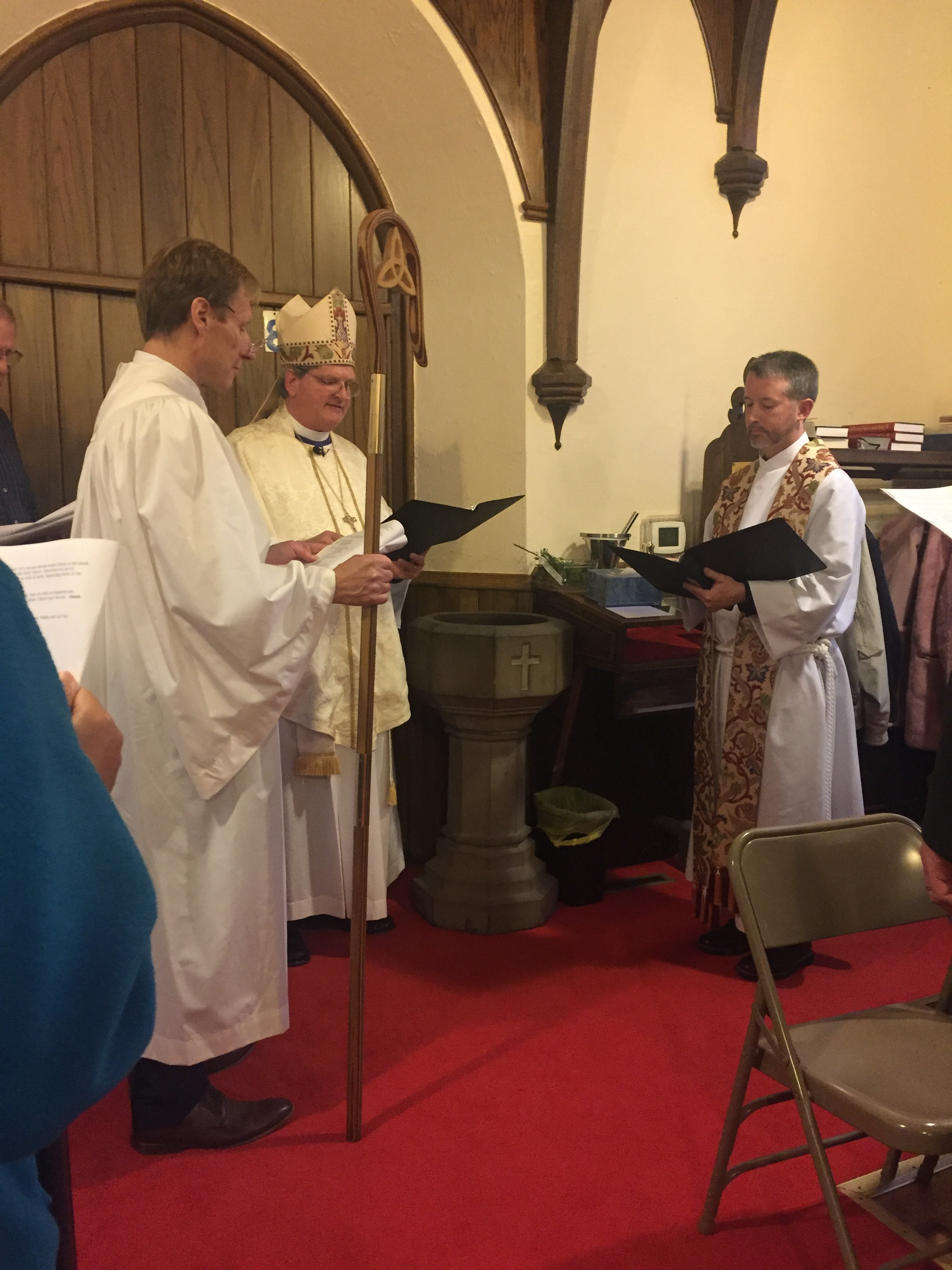 l-r: The Senior Warden, Bishop William Stokes and Todd leading the Renewal of Baptismal Vows