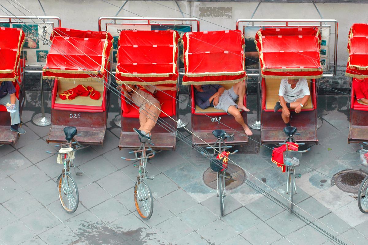 Tourist pedi-cab drivers on break, Beijing, China