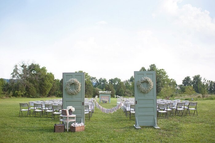 Copy of Vintage rustic details around the entrance to this outdoor wedding with mint and green accent colors