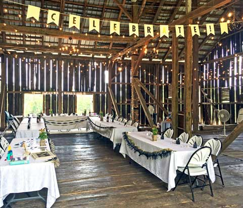 Cheers to Your Happiest Years - This is a 60th wedding anniversary celebration held in our Historic Barn Event Venue. Celebrate your happiest years with your spouse, family and friends in a truly one-of-a-kind event venue. Get crafty with decor and transform the barn with your own unique rustic banners. The Historic Barn Event Venue comes with all tables, chairs, and tablecloths pictured to the right.