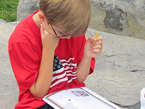 A Junior Ranger works on his activity book. Photo: NPS
