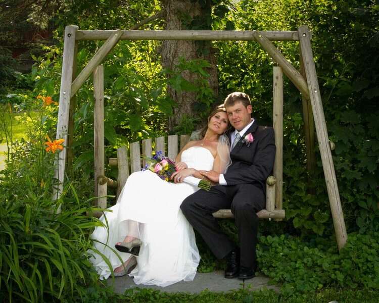 Garden Swing - Cozy up on our wood swing, perfect for intimate photos.Photography by: Deborah Hurd