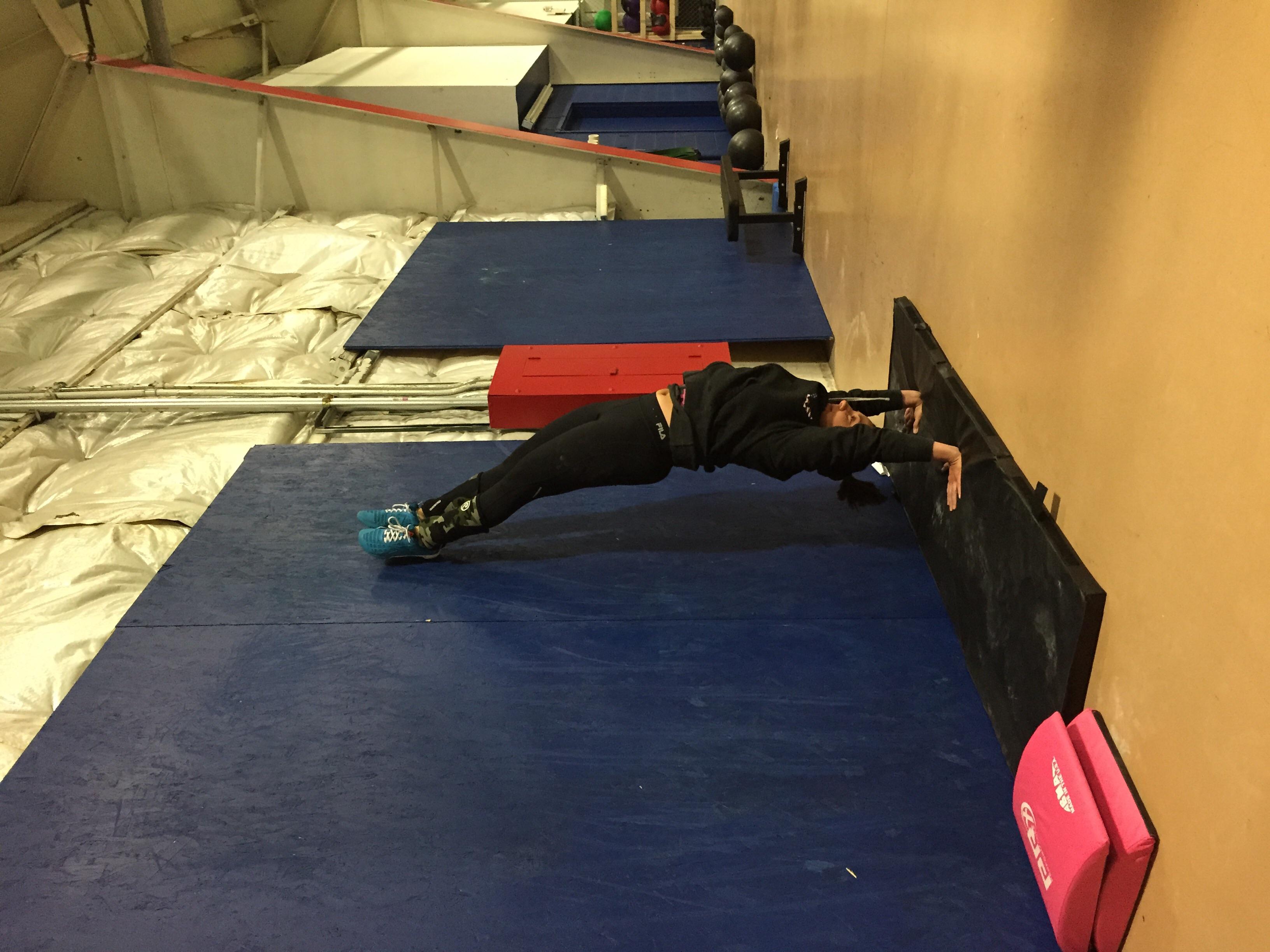 Kristen working on her handstand position.