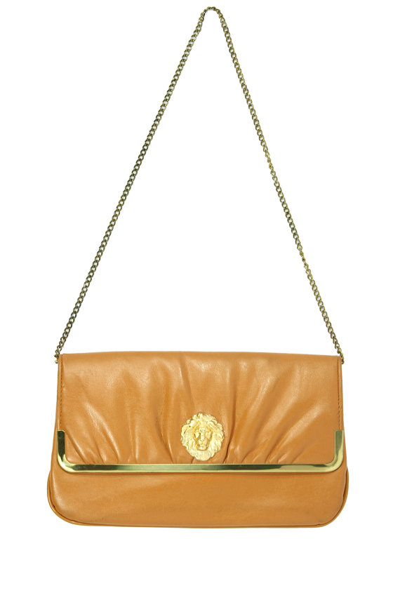 Adorned with our Signature Guilded  Lions Head, pair this bag with tapered skinnies and a structured statement blazer