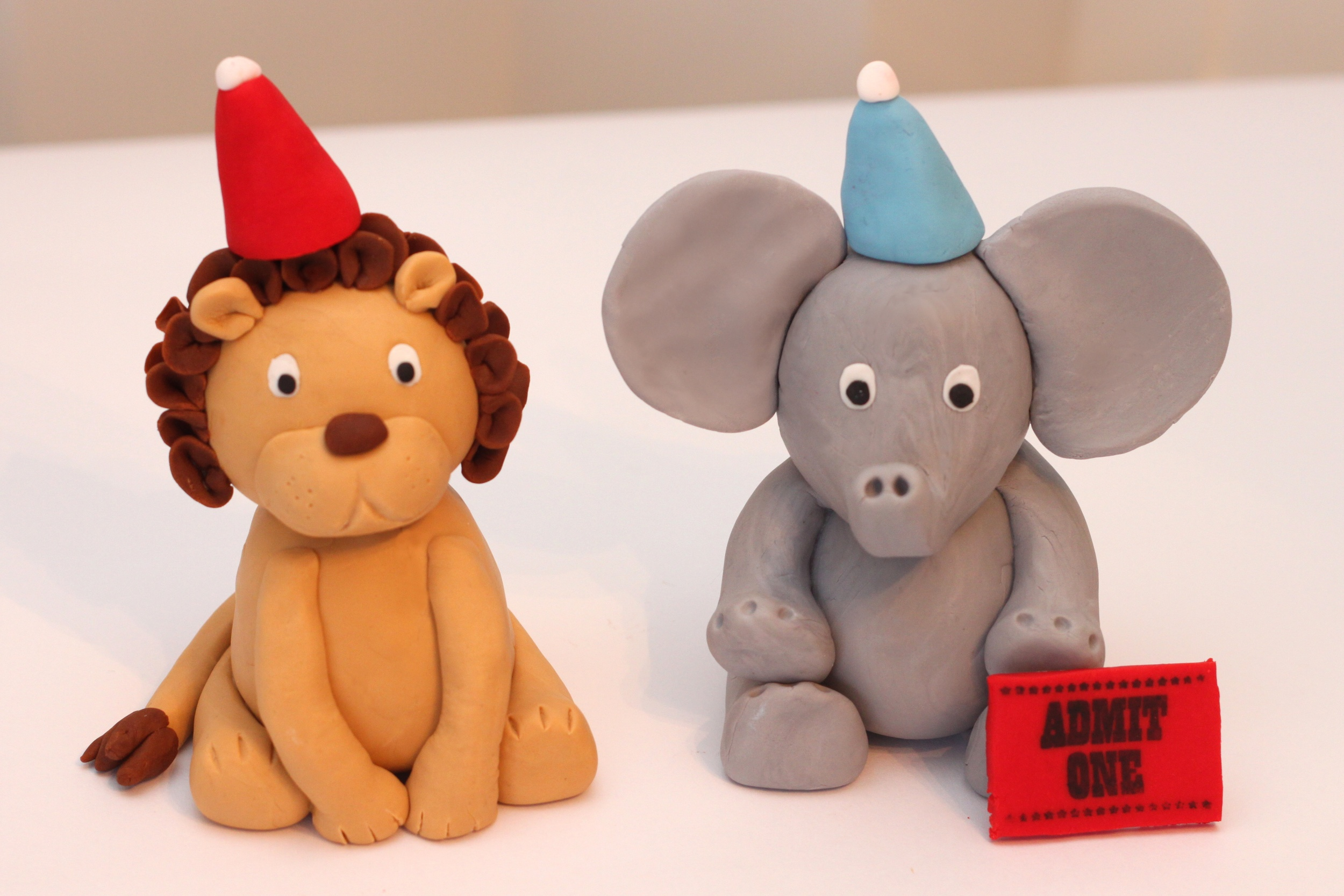 Circus toppers lion elephant.jpg