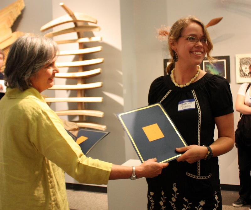 Shannon accepting a 2D Merit award at the 6th Annual BRCC Student Art Show