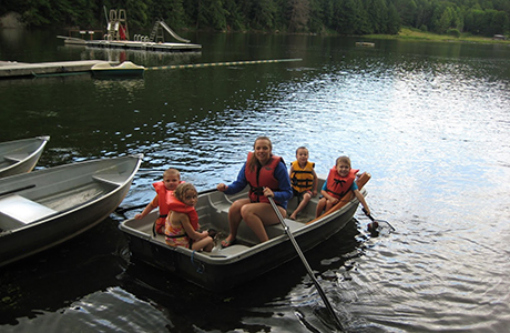 "Lotus Lake Day Camp   Established in 1952, Lotus Lake Day Camp provides a tradition of day camping to children ages four to fourteen. Situated in a rural setting in central Vermont, the camp offers a wide variety of outdoor activities, including swimming, boating, horseback riding, archery, and more. We have been called a ""real Vermont camp.""   Visit Lotus Lake Day Camp →"