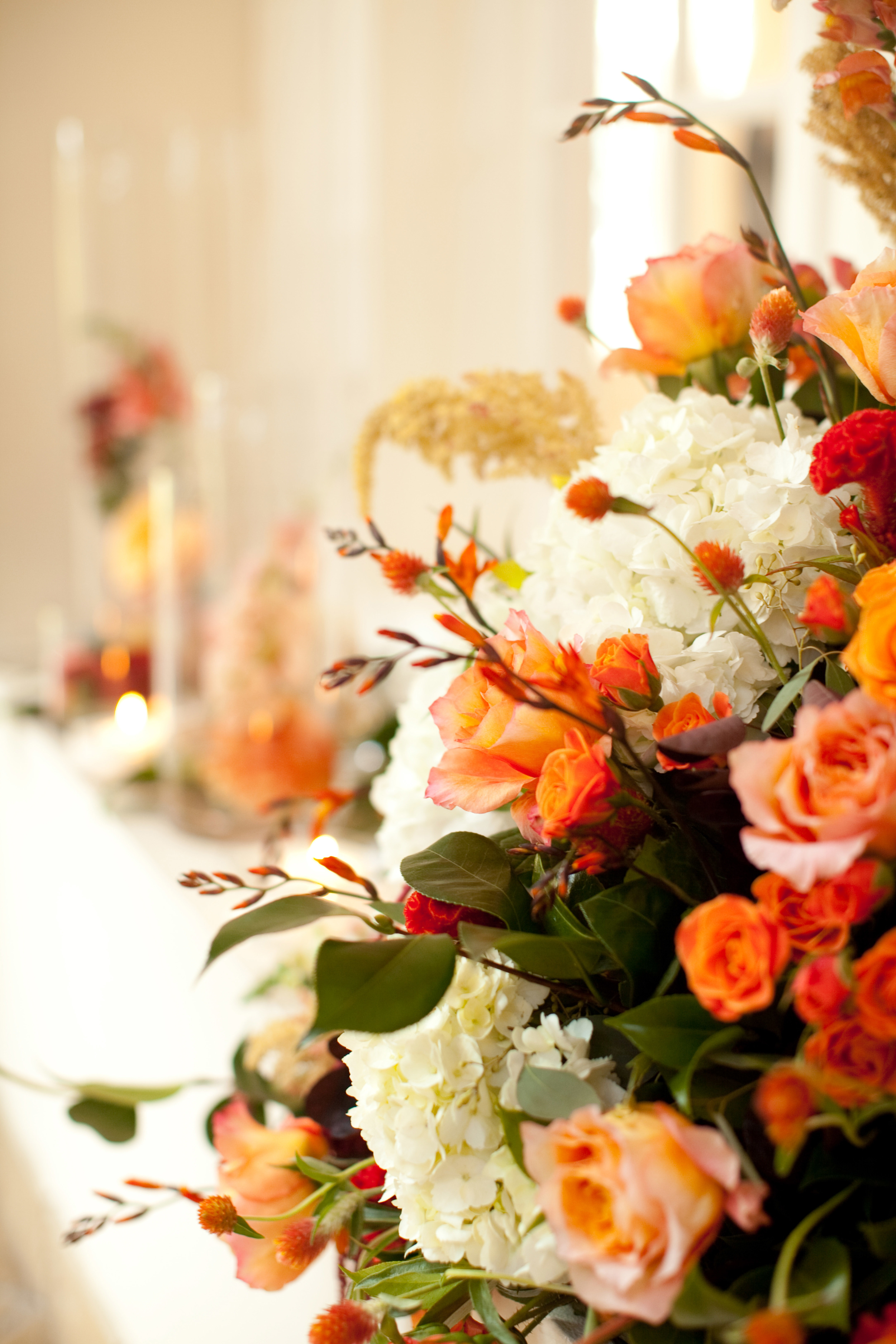 Fresh floral centerpieces    in creams, pale oranges and rusts.