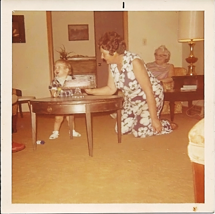 """My mom(grandmother) and me. I'm guessing it was my first birthday. I believe in the back that is """"Aunt"""" May. She lived to be 103. My mom passed away about 15 years ago."""