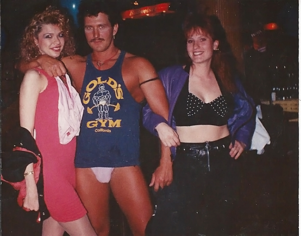 Me, some random stripper, and Trish.  No, those are not my panties he's holding.  He did have an impressive mullet though.  This was taken at Joshuas in Grandview, MO.  It was a club in a crappy hotel that we went to ALL the time.  I was 21, I think Trish was still 20 - not even legal ;)  Course, we did lots of things that weren't legal then LOL!  I loved her dearly, one of my eternally EPIC BFFs