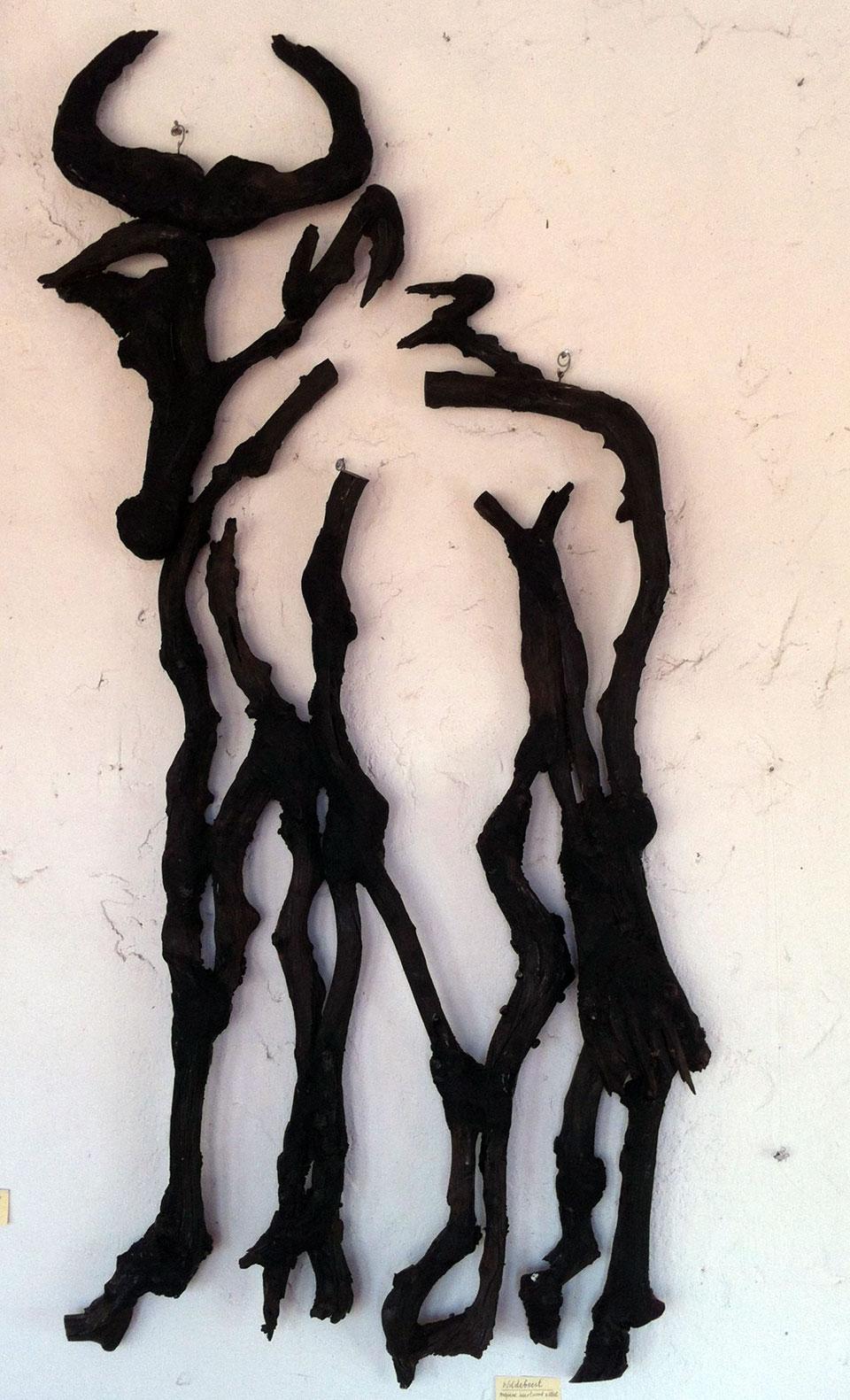 Wildebeest . Mopane heartwood and steel. 130 x 190cms. (2014)