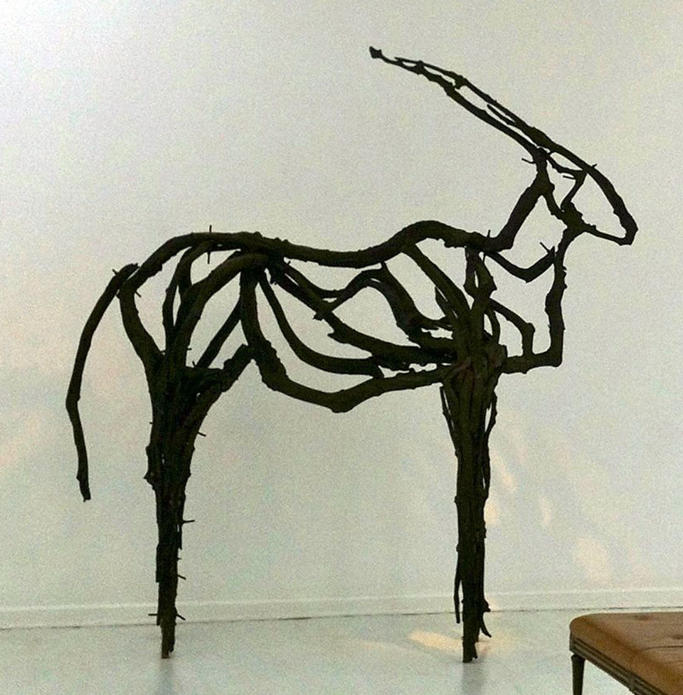 Invisible Eland . Mopane heartwood and steel. 300 x 350 cm. (2014)