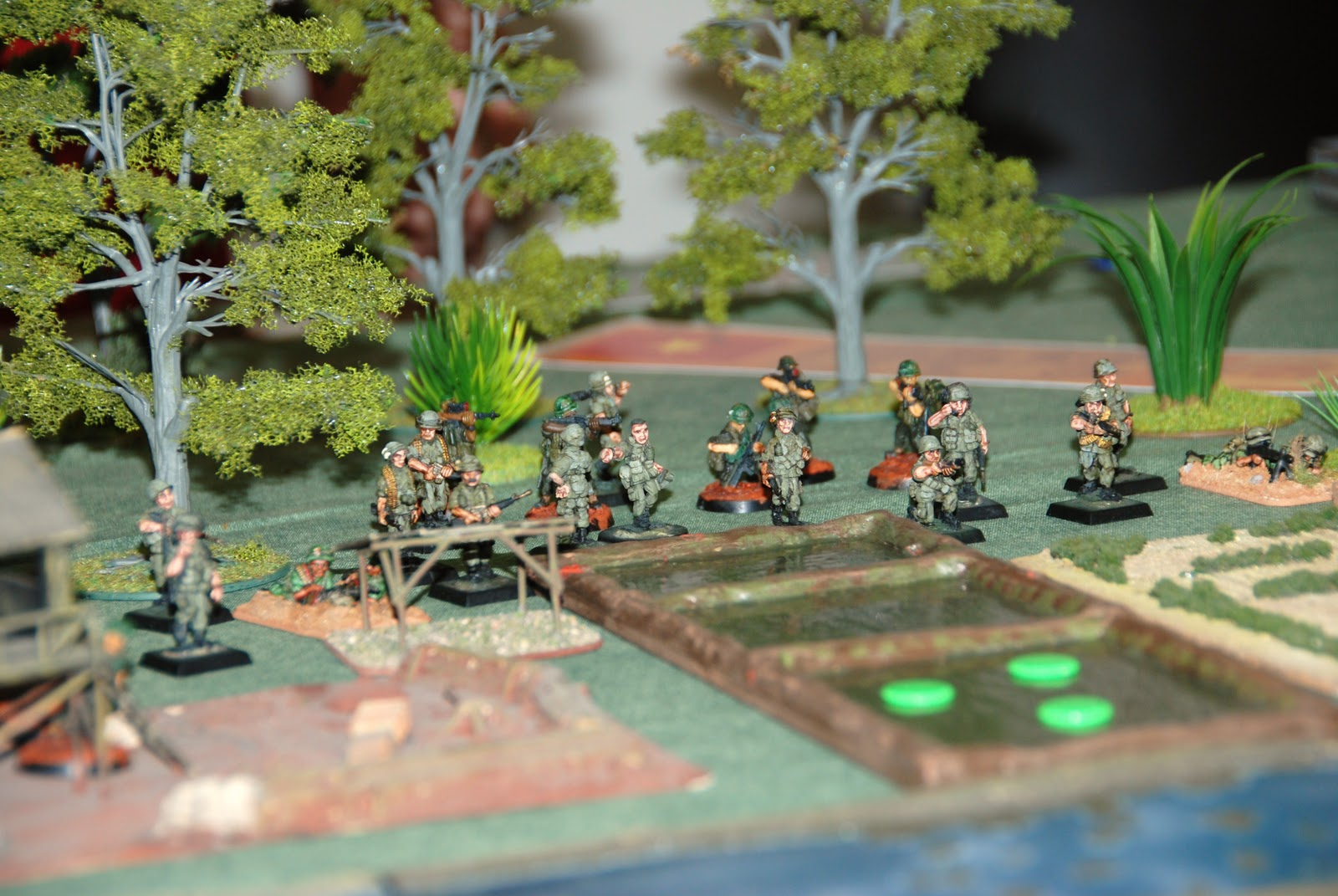 The other platoon moved to its left and deployed along a line of rice fields.