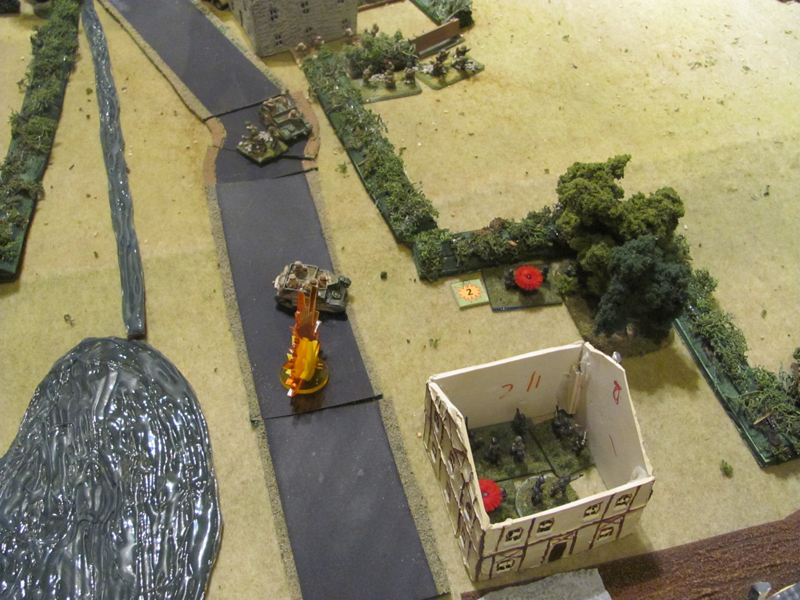 Danger! A Vickers MMG carrier braves their own artillery fire to get into position to engage the Germans in the town (and escape the PaK40!)