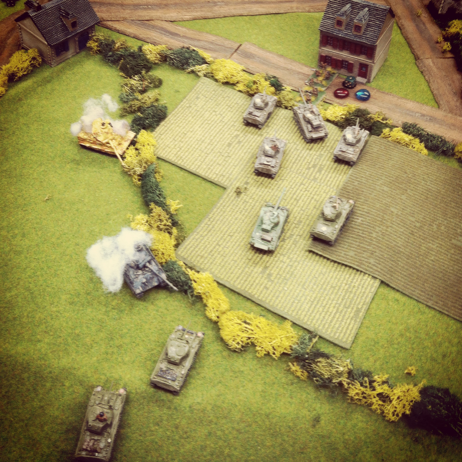 With German armor aflame, Canadian tanks roll to seize the objective