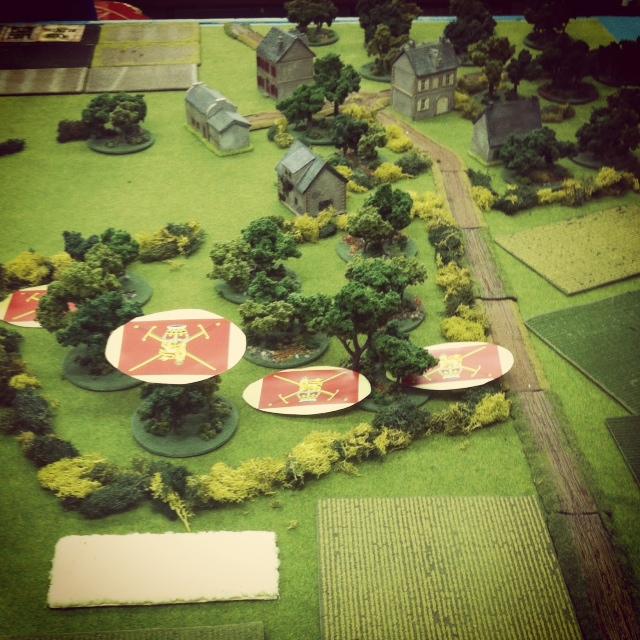 British infantry advance   under Blinds  through an orchard north of Caen