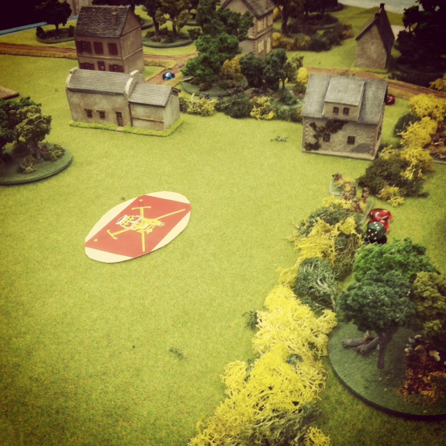 British platoon runs bravely under a Blind across an open field between two barns