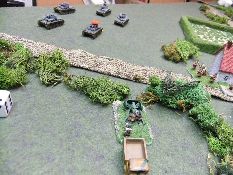 Panzers flank the town, the French At gun got one shot off then died under a hail of counter fire
