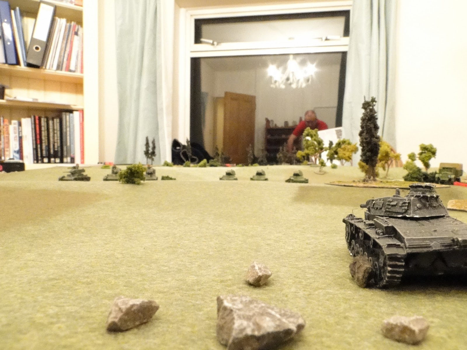 The Panzer IIIs clock two platoons of T-26s moving into hull down positions.