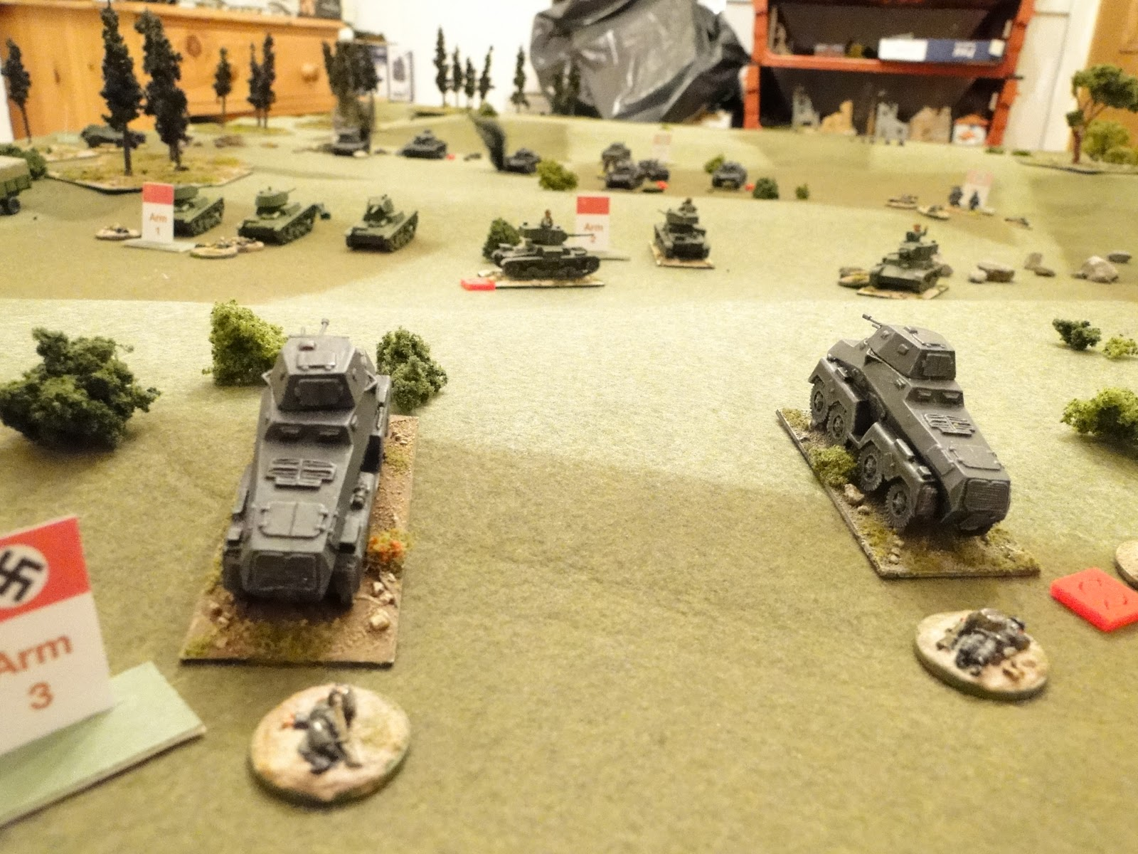 German recce turns back to fire on the rear of the Russian tanks.
