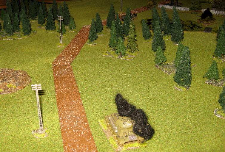 The View From The German Entry Point, Past The Burning T-34