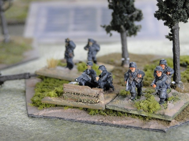 Soviet machine gunners in the open, too good a target, the machine gun bursts into life