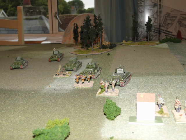 Soviet armour fires High Explosive on the wooded hill: two T34s roll a six in the attack, a third rolls double six. It's all over at the wooded hill as the survivors lose their bottle and retreat to the far side of the hill