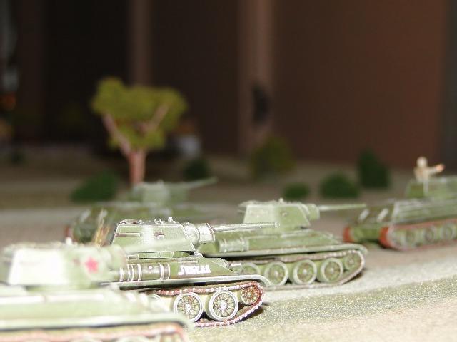 The platoon Big Man signals the advance