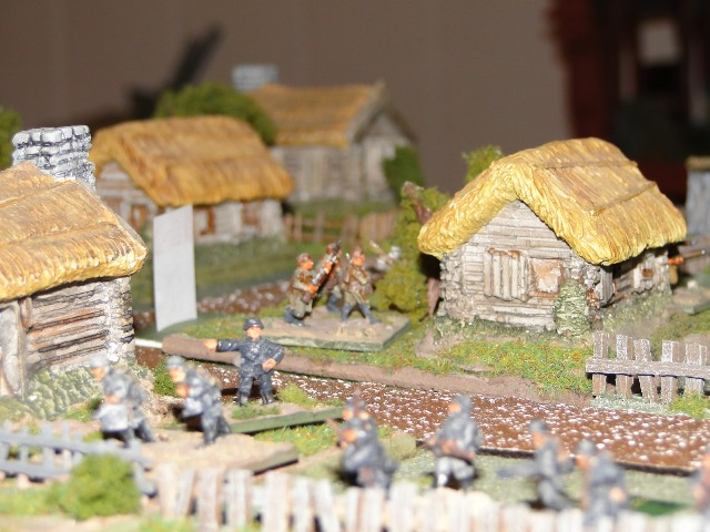 Soviet infantry break into the village