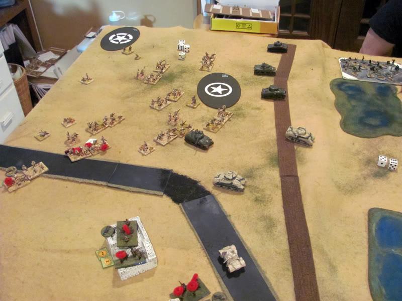 Italian Blackshirt infantry attacks from the vluster of buildings across the bridge