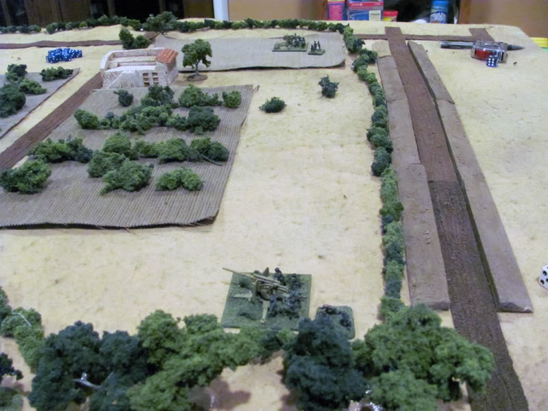 Two German FlaK 36 88mm dual purpose guns reveal their positions in the vineyards and open fire on the Shermans