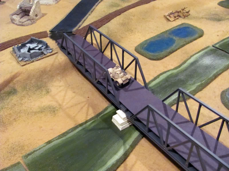 Daimler armoured cars dash across the Ponte Primosole in an attempt to outflank the 88s in the vineyard