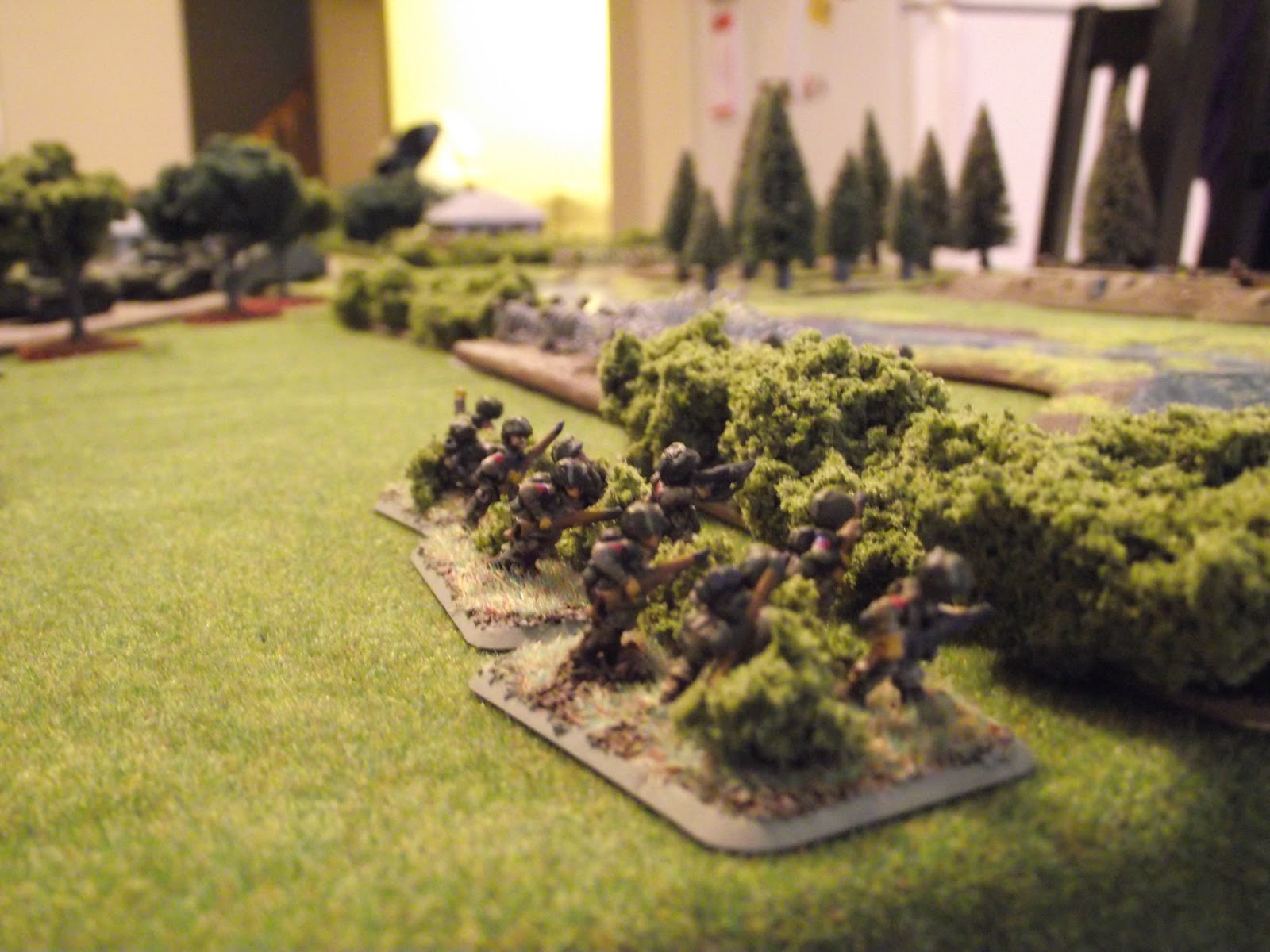 US Paratroops move up to lay some fire down on the Germans across the river in the trench.