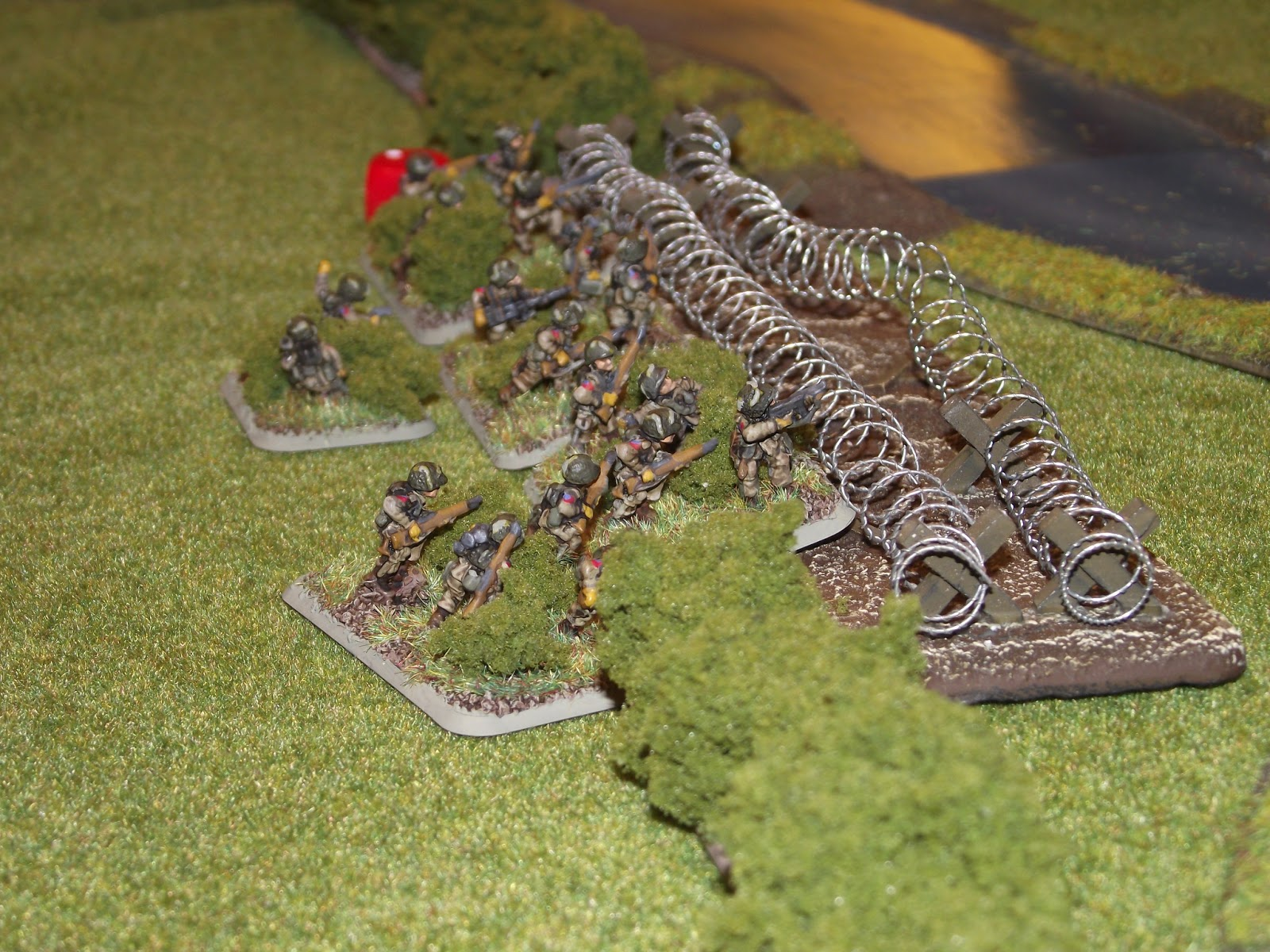 Paras tied up on the barbed wire. The Germans would pepper them with MG fire and force them back.