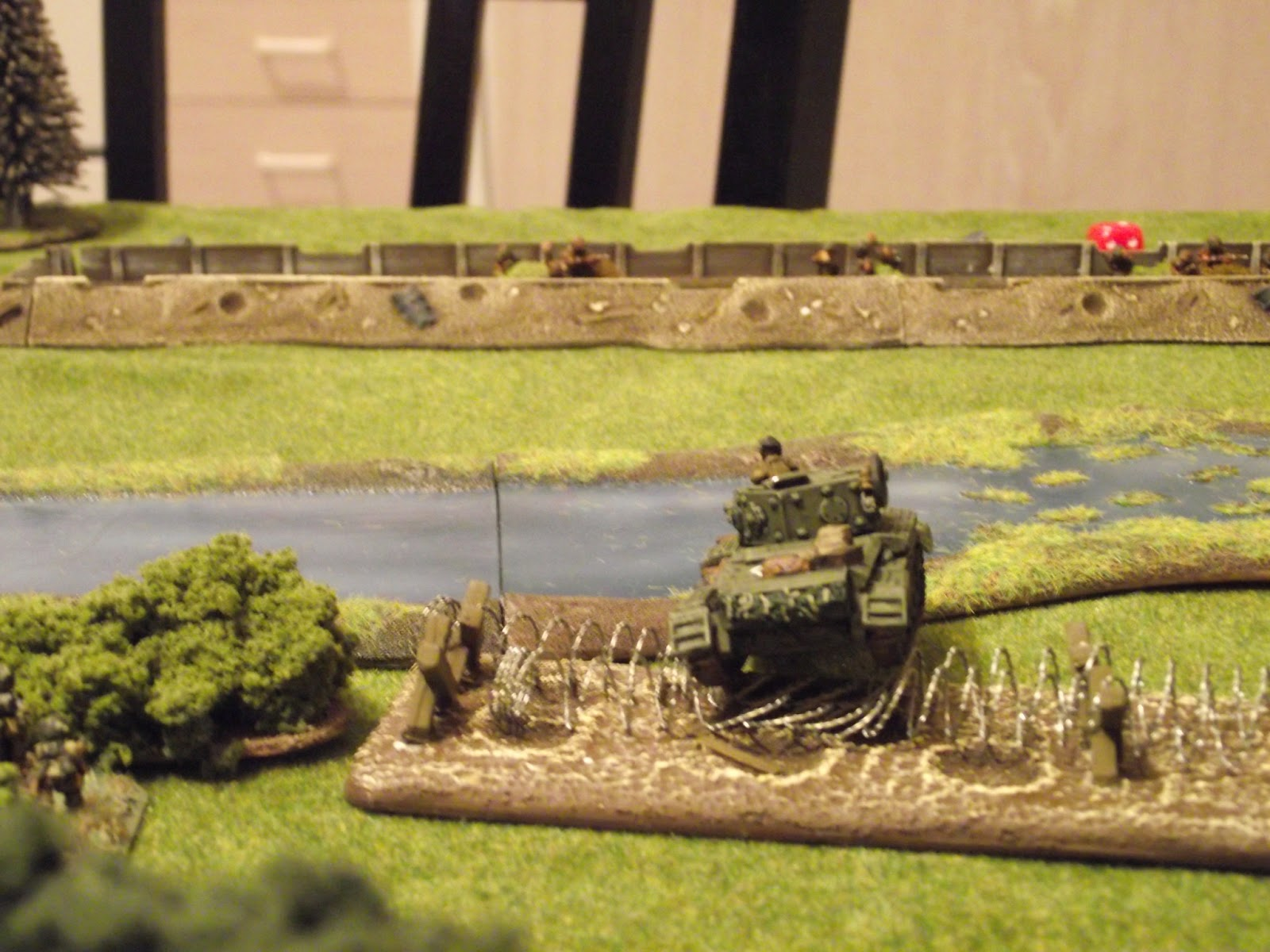 British Cromwell starts crossing the barbed wire whilst laying HE fire on the trench.