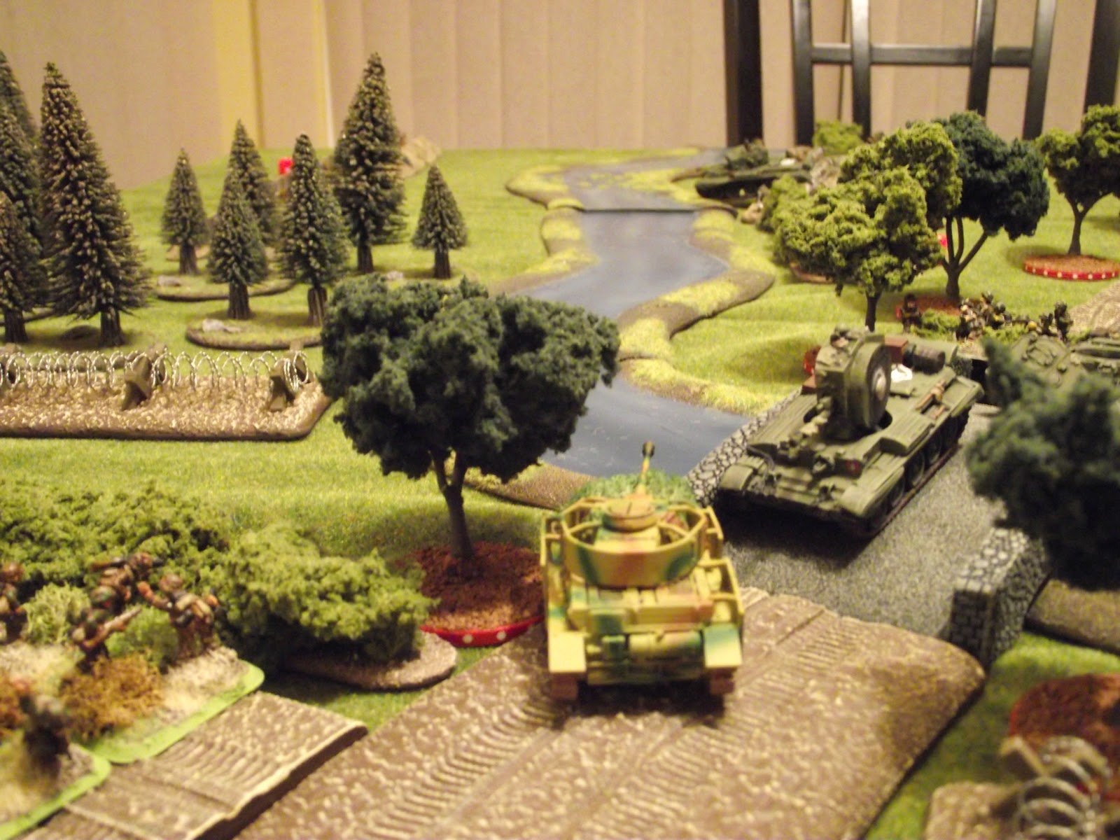 The Panzer IV survives the Challenger's shooting and rushes to the bridge to get a flank shot on the remaining Cromwell trying to cross the ford.