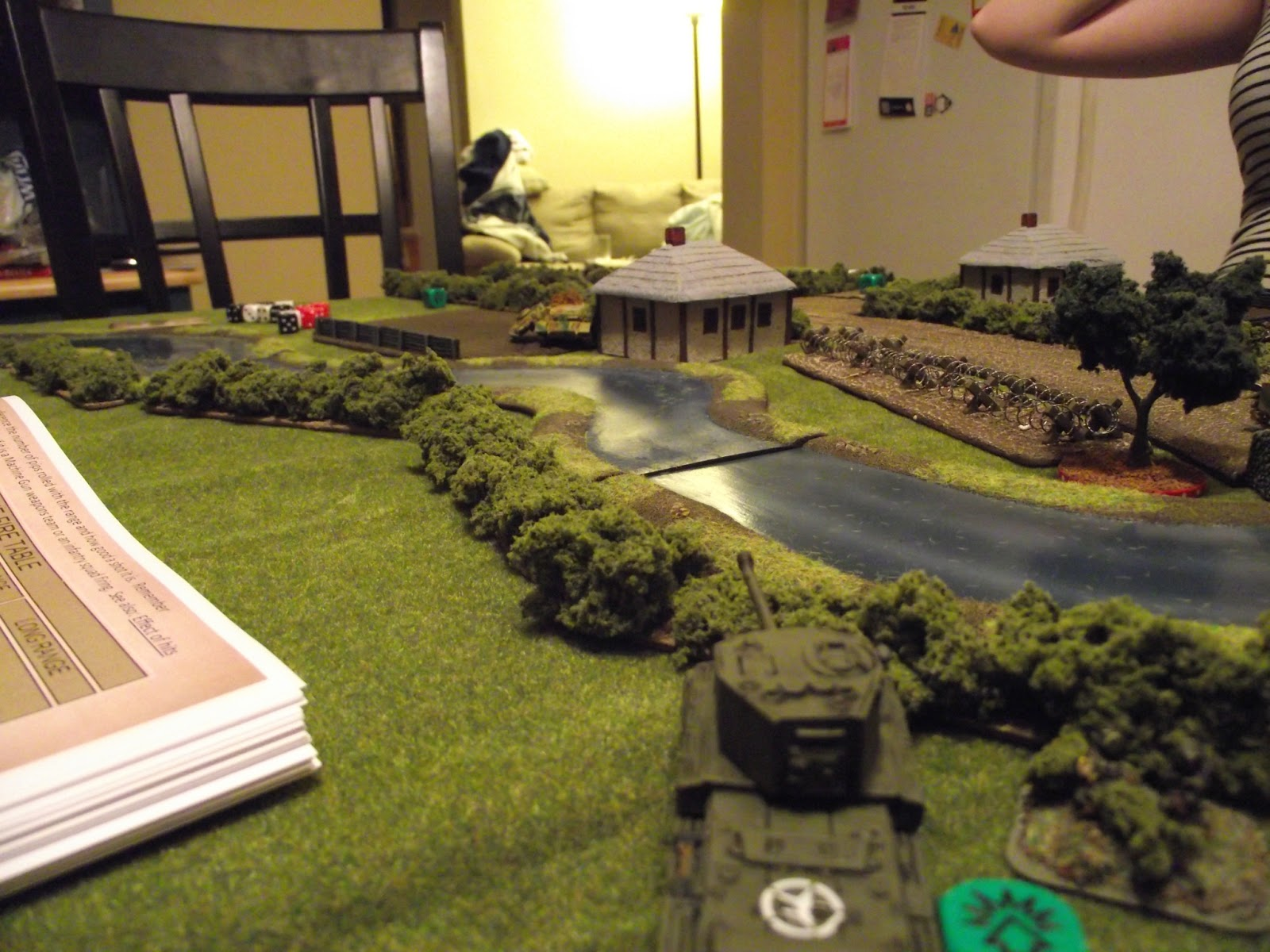 Challenger turns its attention to the second Panzer IV hiding behind the farmhouse.
