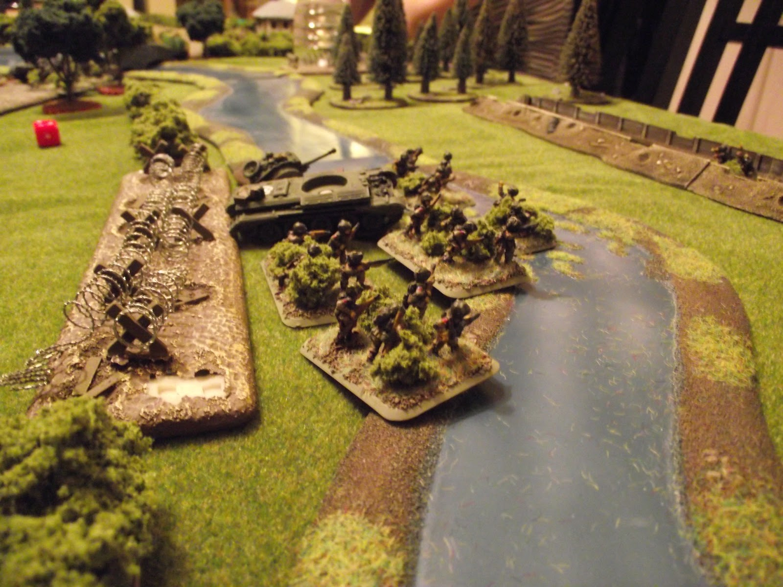 The Paras try to avenge its loss. They cross the barbed wire and try and storm the trench.